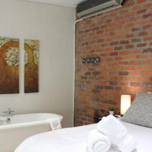 314 Westside Studios - Bedroom on Mezzanine Level with Freestanding Bath.